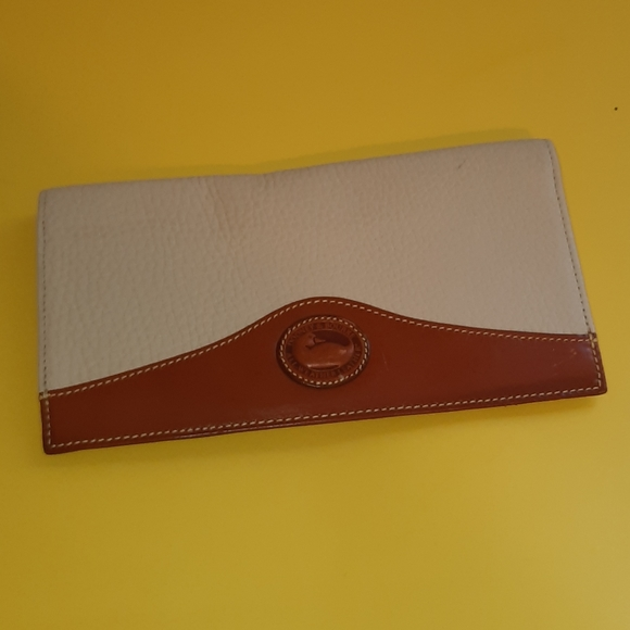 Dooney and bourke new checkbook cover.